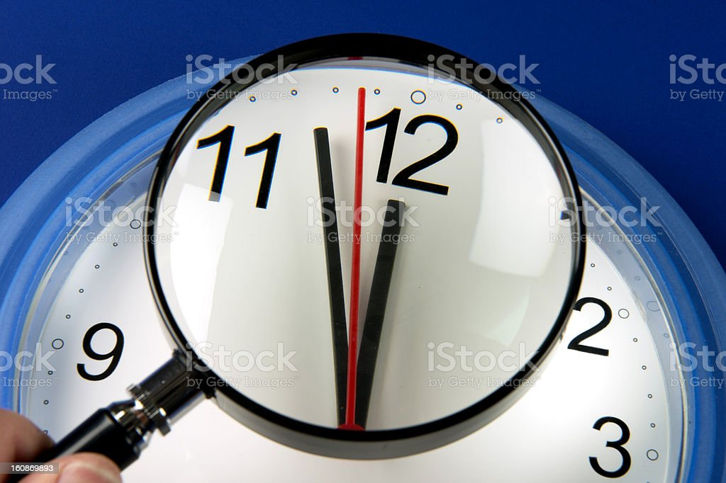 Closeup clock hands about to hit midnight or noon royalty-free stock photo