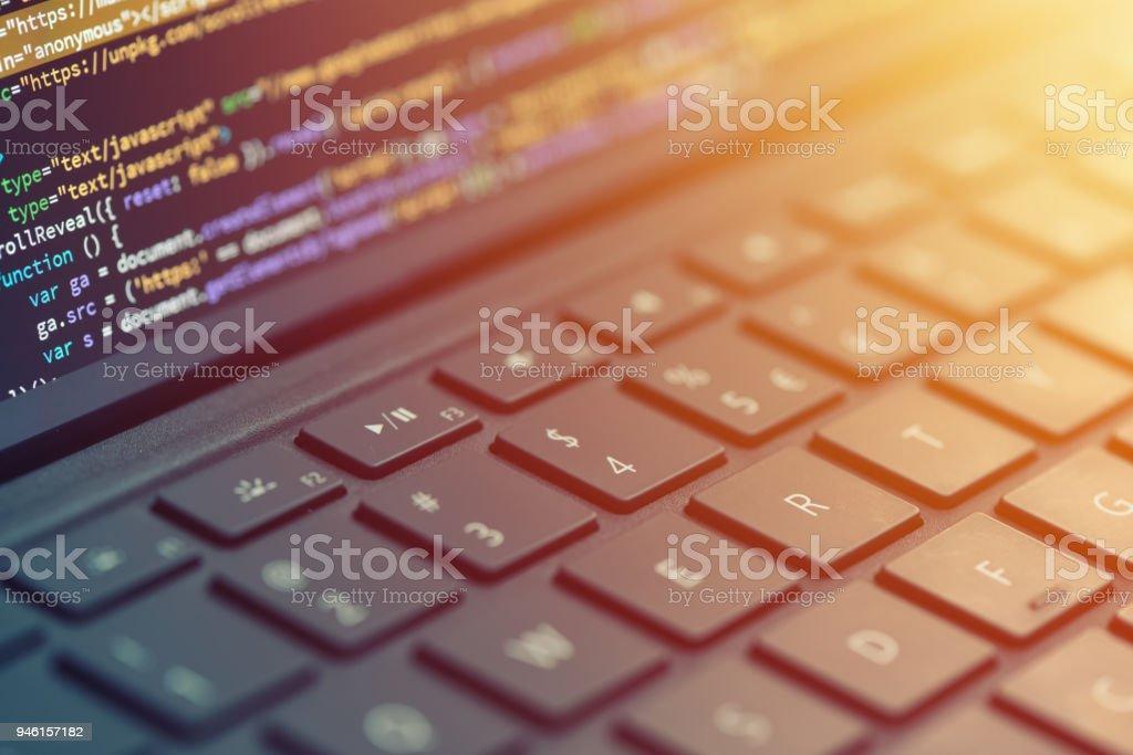 Closeup coding on screen, hands coding html and programming on screen laptop, web development, developer royalty-free stock photo