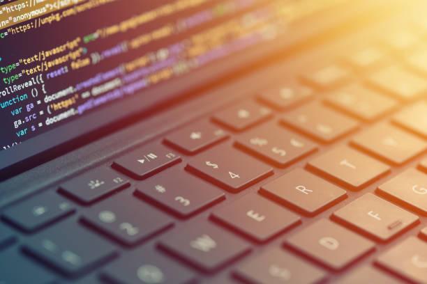 Closeup coding on screen, hands coding html and programming on screen laptop, web development, developer stock photo