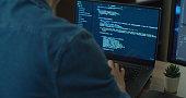 Closeup coding on screen, Man hands coding html and programming on two screen Monitors, development web, developer