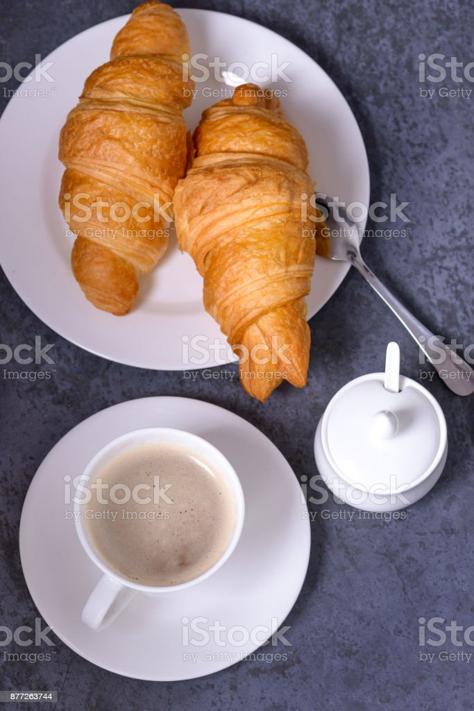 Closeup coffe with croissants on gray stone table stock photo