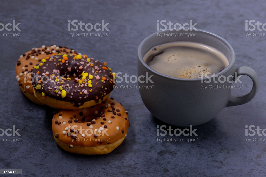 Closeup coffe with donuts stock photo