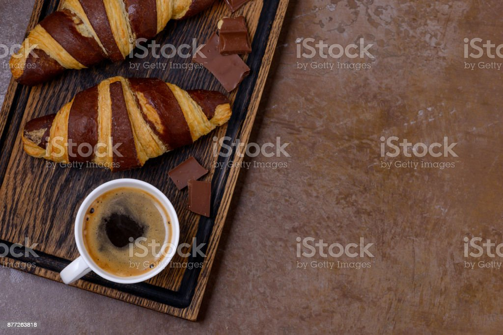 Closeup coffee and chocolate croissant and chocolatier stock photo