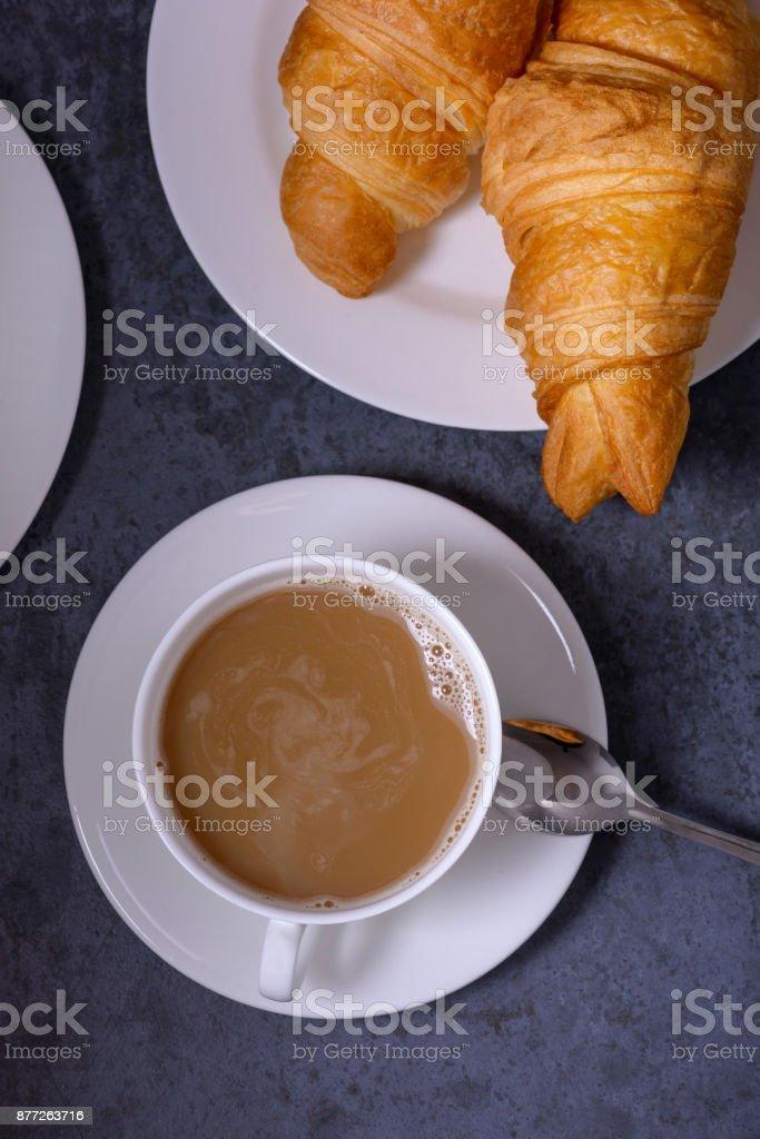Closeup coffee and fresh croissants stock photo