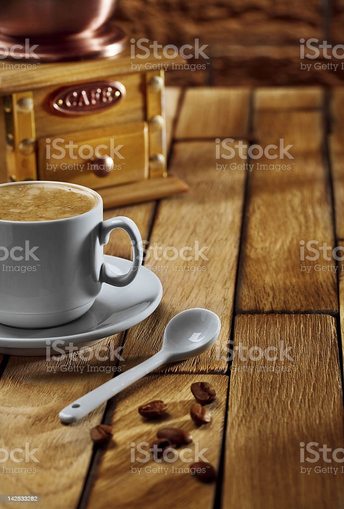 close-up coffee cup and grinder on wooden table royalty-free stock photo
