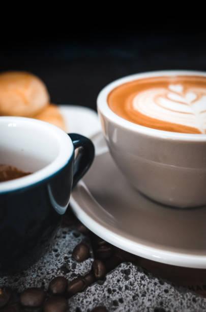 Closeup Coffee latte art with bread stock photo