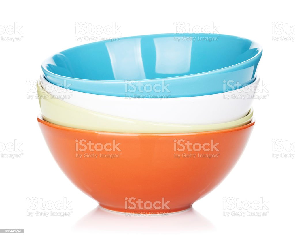 Close-up colorful bowls on white background stock photo