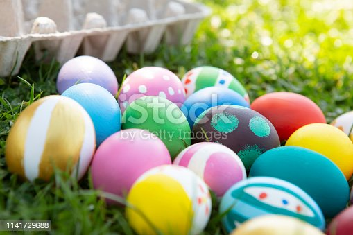 Close-up Colorful Easter eggs on green grass