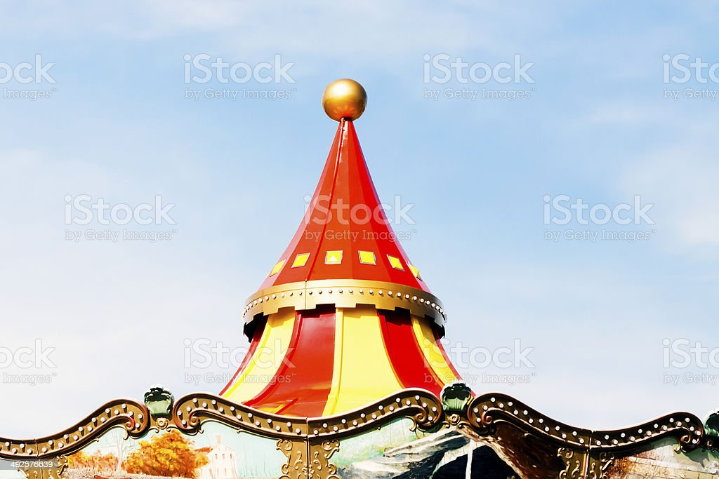 Closeup colourful circus tent against blue sky, copy space stock photo