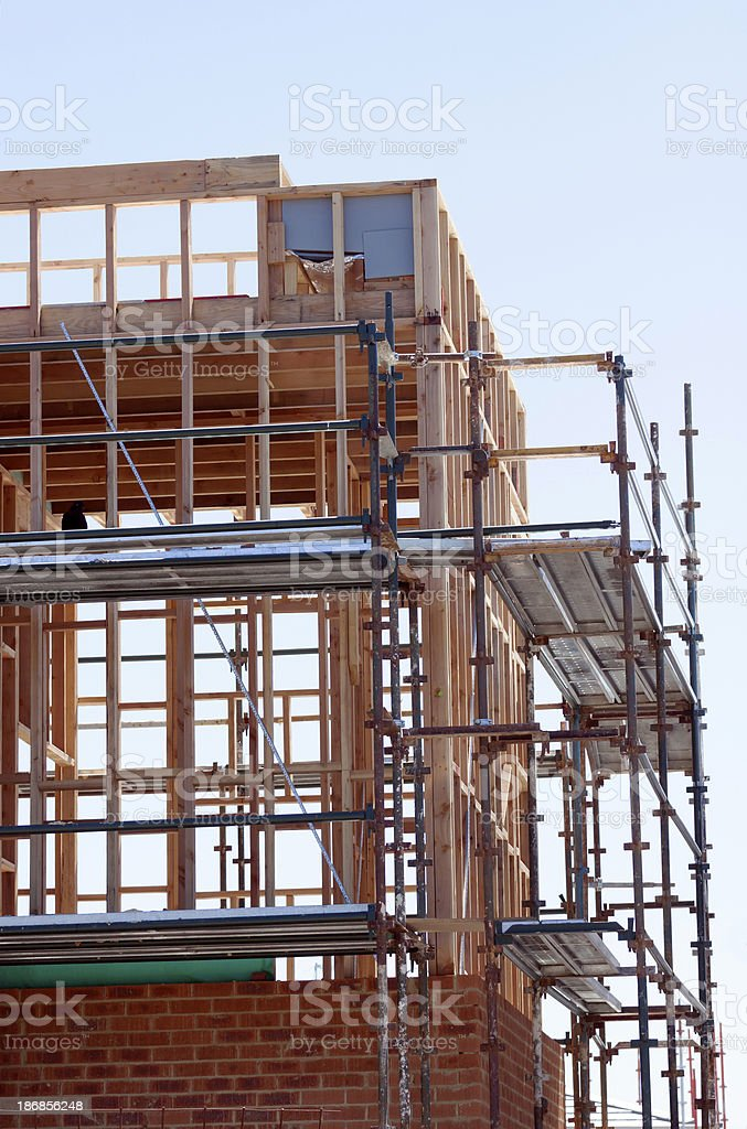 Closeup construction of new brick house with scaffolding, copy space royalty-free stock photo