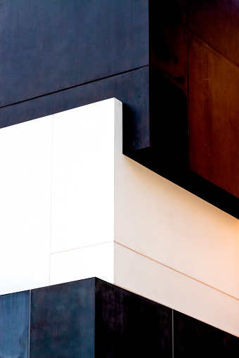 Closeup corner of modern building, abstract background with copy space, vertical composition