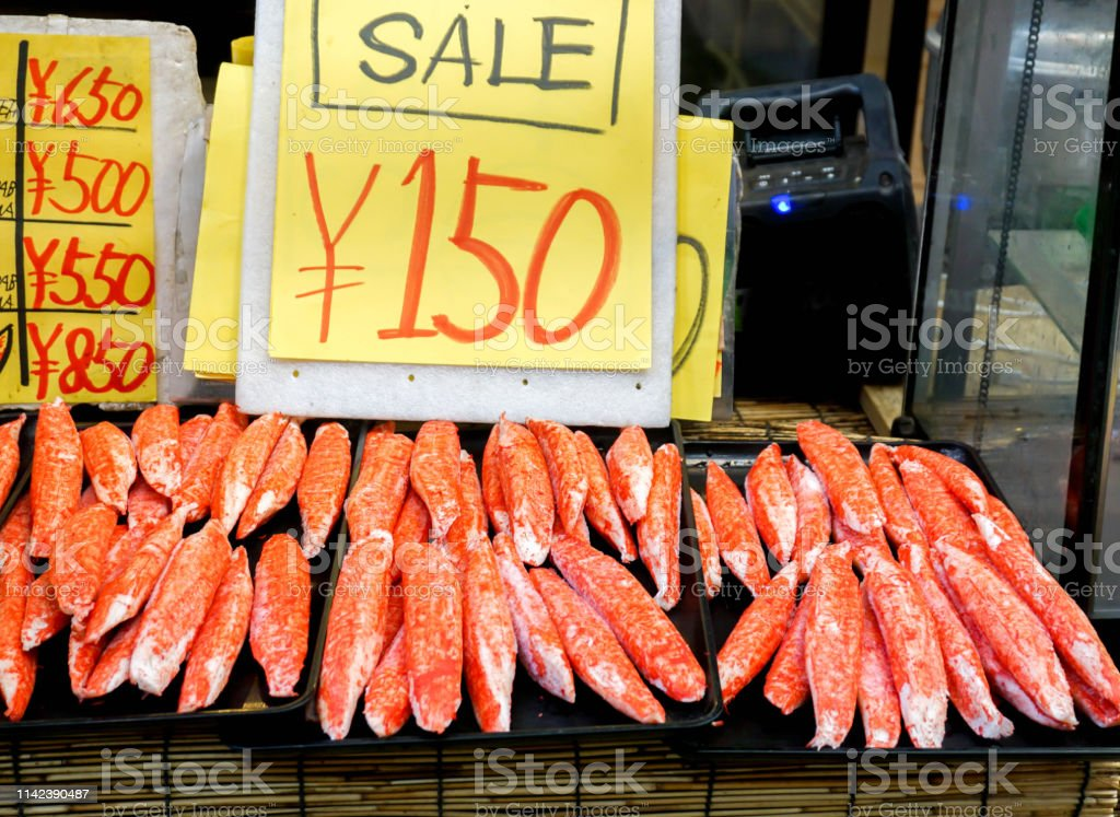 Closeup Crab Sticks And King Crab Legs Meat With Price Tag