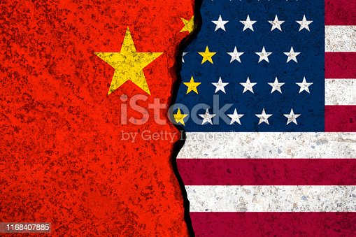 928696036 istock photo Closeup crack of USA flag and China flag .It is symbol of tariff trade war crisis between United States of America and China which the biggest economic country in the world. 1168407885