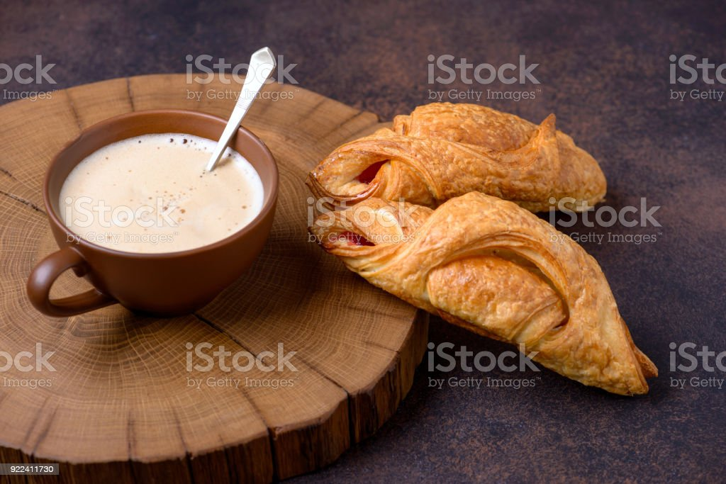 Closeup croissants and coffee on table stock photo