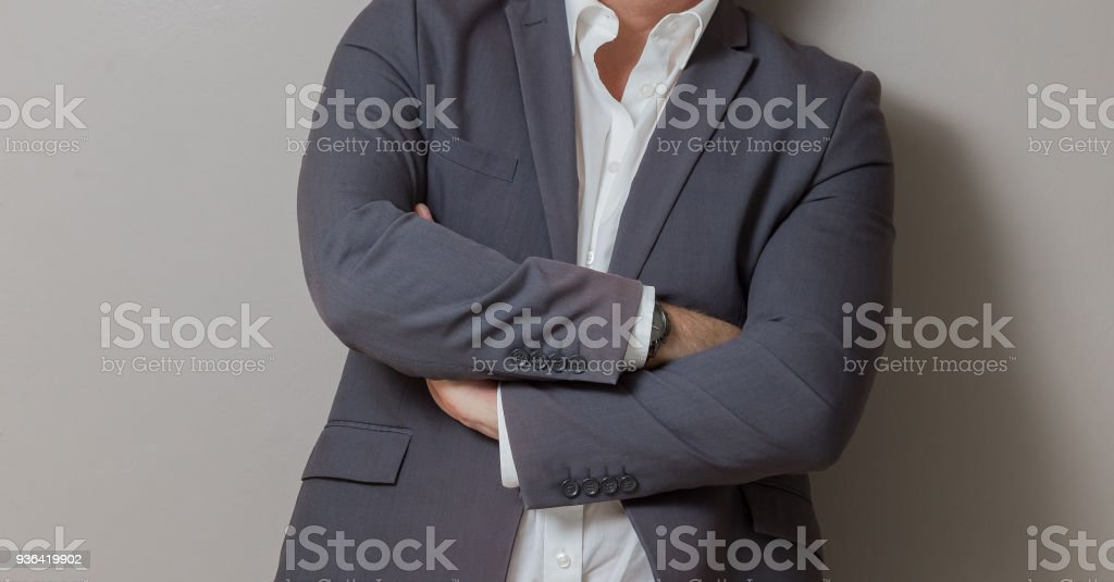 Close-up cropped Caucasian hands and arms of businessman stock photo