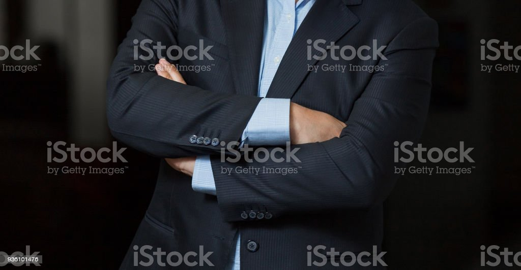 Close-up cropped Caucasian man hands and arms folded stock photo