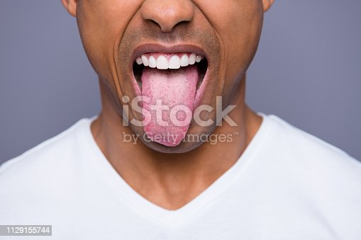 Close-up cropped portrait of his he handsome attractive well-groomed virile funky guy wearing white shirt showing tongue out isolated over gray violet purple pastel background