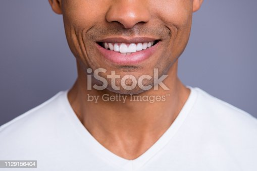 Close-up cropped portrait of nice handsome attractive cheerful cheery well-groomed guy wearing white shirt beaming shine teeth isolated over gray violet purple pastel background