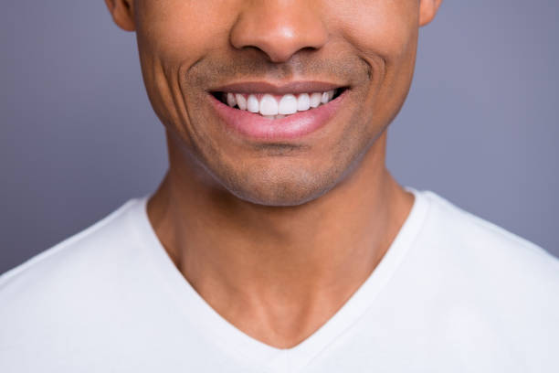 Close-up cropped portrait of nice handsome attractive cheerful cheery well-groomed guy wearing white shirt beaming shine teeth isolated over gray violet purple pastel background Close-up cropped portrait of nice handsome attractive cheerful cheery well-groomed guy wearing white shirt beaming shine teeth isolated over gray violet purple pastel background teeth stock pictures, royalty-free photos & images