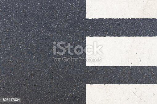 istock close-up crosswalk (zebra crossing) on road, top view 807447004