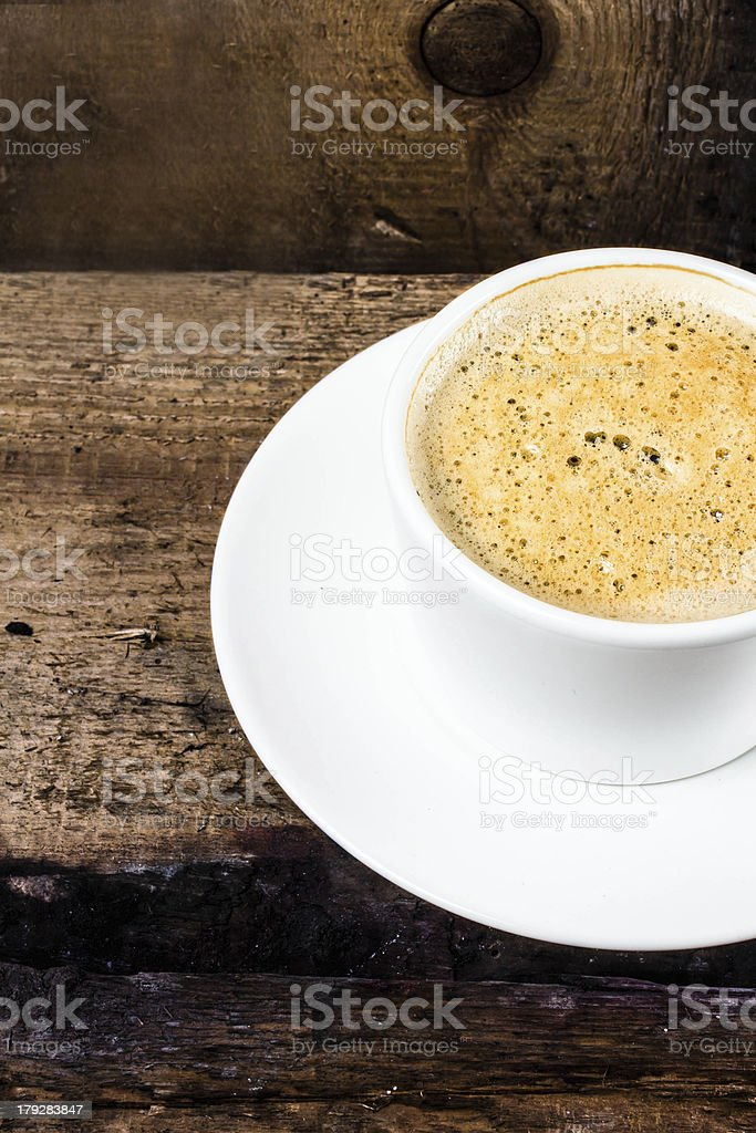 Closeup cup of espresso on old wooden table royalty-free stock photo
