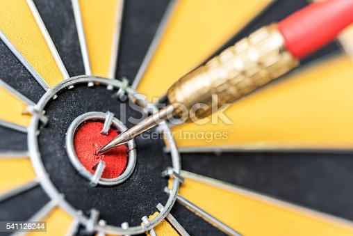 istock Closeup dart target with arrow on bullseye 541126244