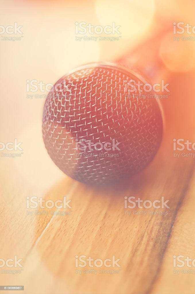 Closeup detail of a microphone with bokeh lights. Soft focus. stock photo