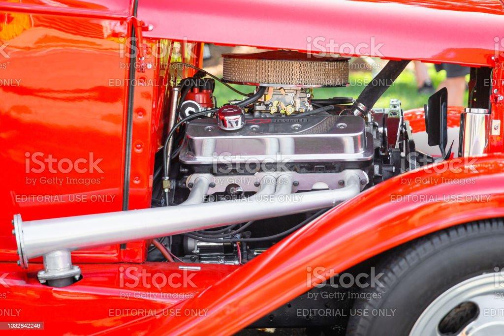 Closeup detail of a shiny chrome Chevy car engine at the Matthews Auto Reunion stock photo
