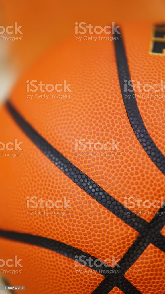 Closeup detail of orange basketball ball texture background