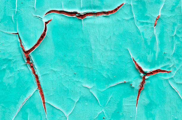 close-up detail of cracked paint on old wall - imperfection stock photos and pictures
