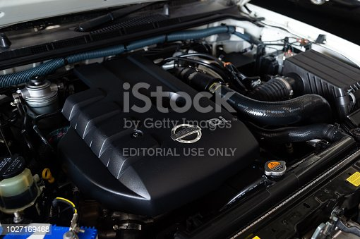 CHIANG RAI, THAILAND-AUGUST 21, 2018, closeup detail of new car engine with soft-focus and over light in the background