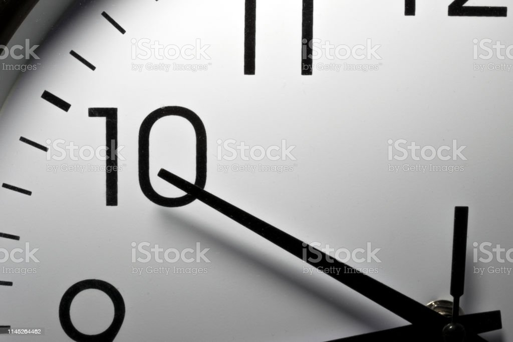 Detail close up of the hands of a kitchen clock, marking 10 o\'clock