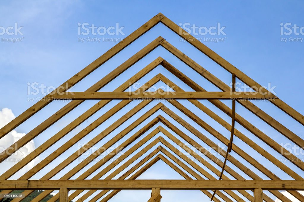 Closeup Detail Of Wooden High Steep Roof Framing Under Construction