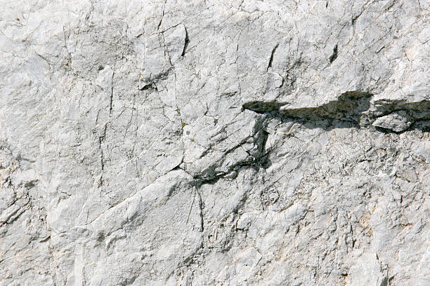 Close-up detailed photo of a light gray stone background stock photo