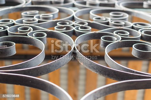 istock Closeup Details of a Black Wrought Iron Fence 525023648