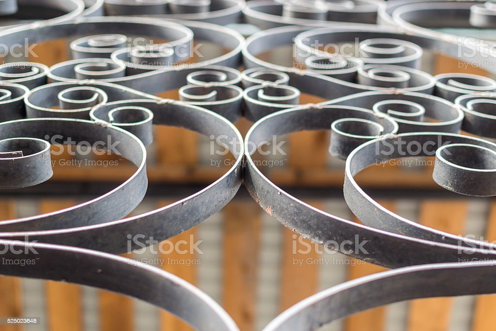 Closeup Details of a Black Wrought Iron Fence stock photo