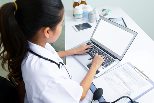 istock Close-up Doctor at hospital working with laptop 1089569202