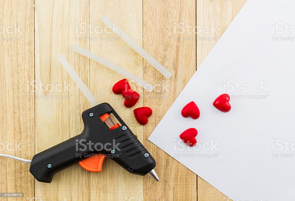 Closeup electric hot glue gun. stock photo