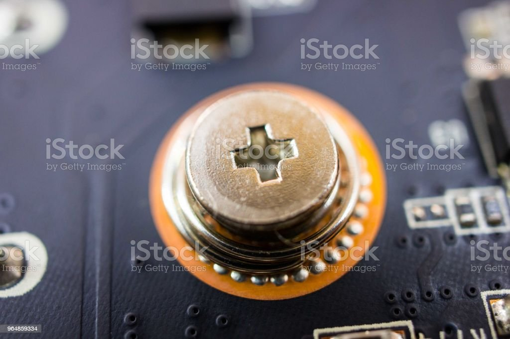 Close-up electronic board screw royalty-free stock photo