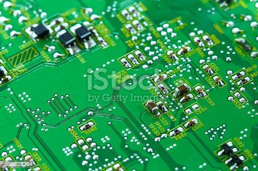 istock Closeup electronic circuit board 595323364
