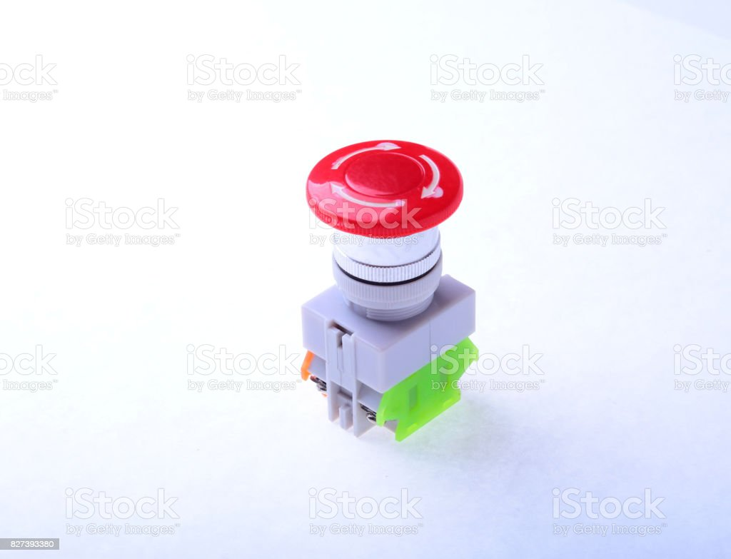 Close-up emergency stop button isolated on white background. stock photo