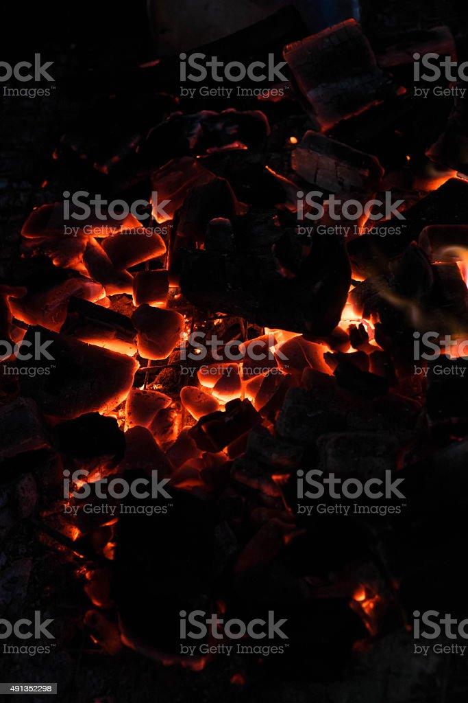 Close-up extinguish fire coal in stove stock photo