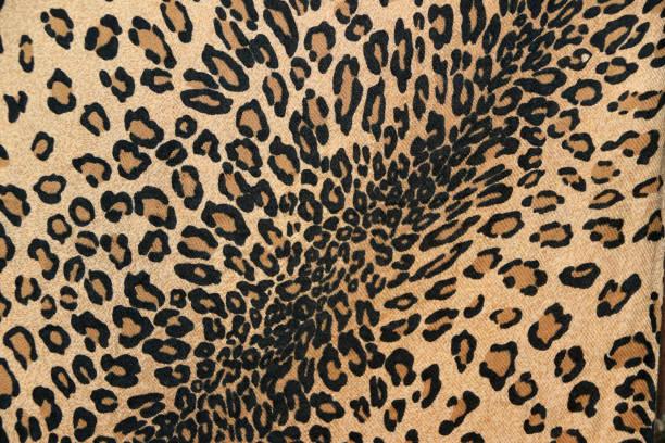 Patrón de la tela del primer plano de tigre leopardo, en color naranja y crema marrón negro. - foto de stock
