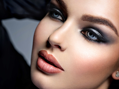 closeup face of a beautiful girl with makeup in style