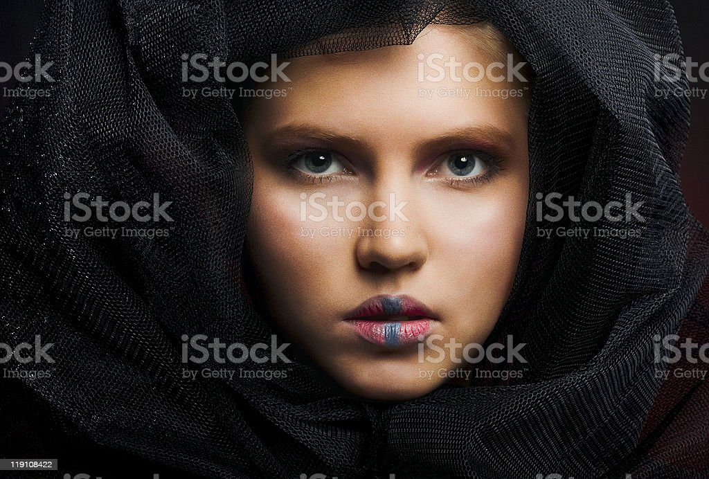 Close-up face of beautiful caucasian blonde woman with extreme  make-up royalty-free stock photo