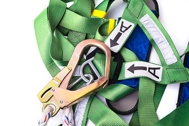 Closeup fall protection harness and lanyard for work at heights Closeup fall protection harness and lanyard for work at heights on white background.Closeup at safety hook. safety harness stock pictures, royalty-free photos & images