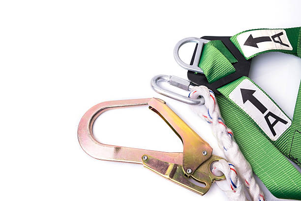 Closeup fall protection Closeup fall protection harness and lanyard for work at heights on white background.Closeup at safety hook. safety harness stock pictures, royalty-free photos & images