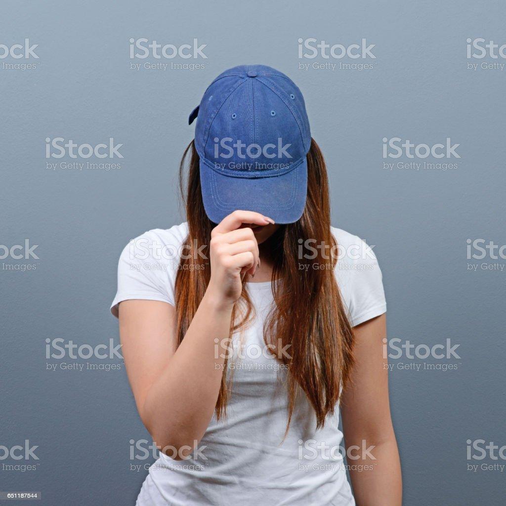 Closeup fashion studio portrait of hipster young woman stock photo