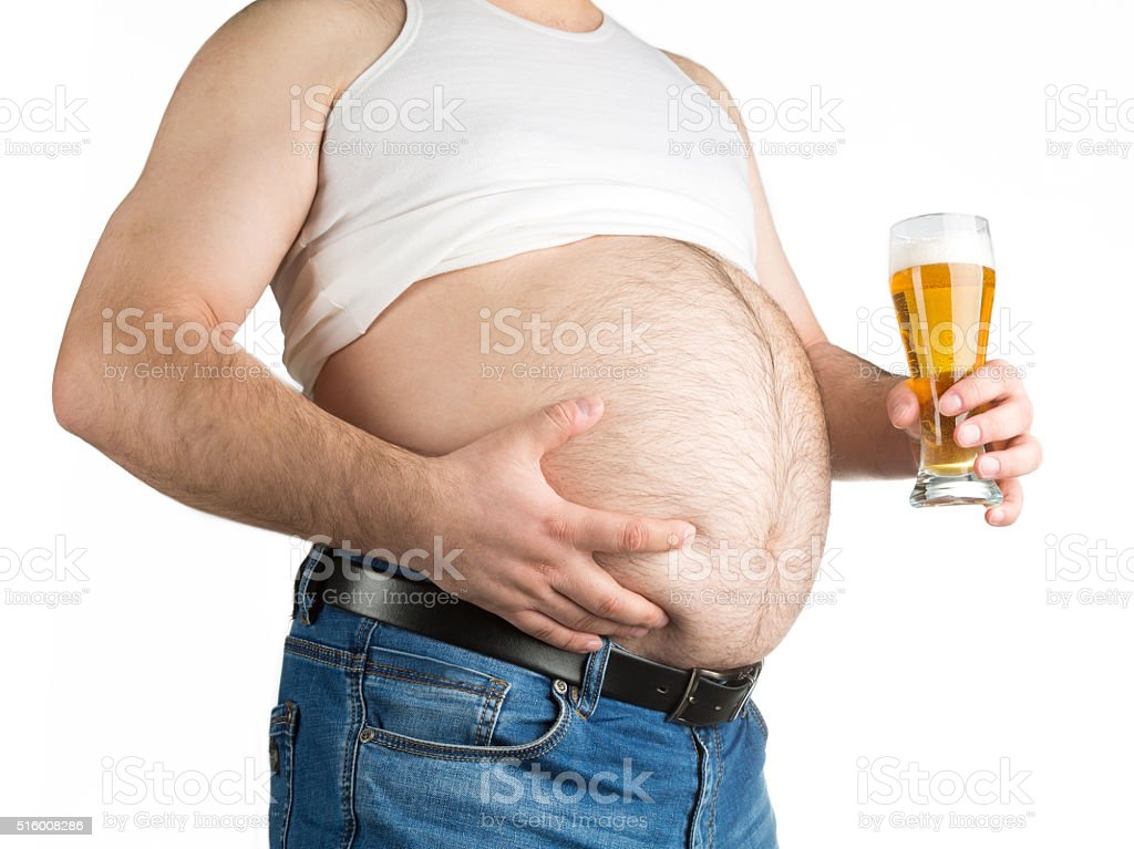 closeup fat belly with beer isolated on white background stock photo