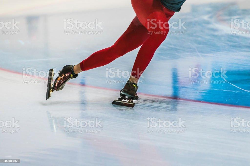closeup feet girl skater riding on ice stock photo